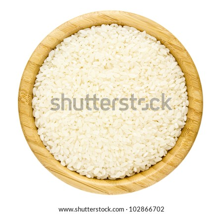White Dry Uncooked Rice in a Bamboo Serving Bowl isolated on a white background - stock photo