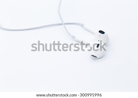 White earbuds isolated on white background - stock photo
