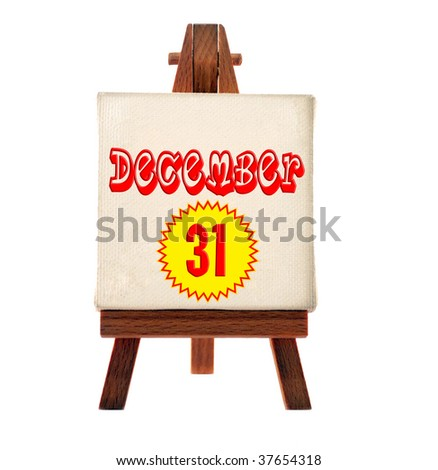 white easel with 31 december text - stock photo