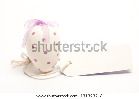White easter egg with blank tag against white background