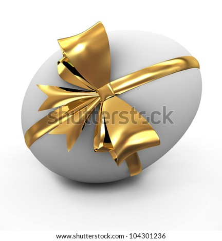 White easter egg with gold ribbon - stock photo