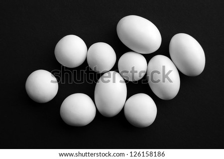 White egg-shaped candies