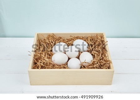 White eggs on a wooden background