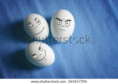White eggs with comical emotional faces - stock photo