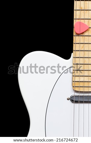 white electric guitar and pink pick on maple fingerboard, isolated on black - stock photo