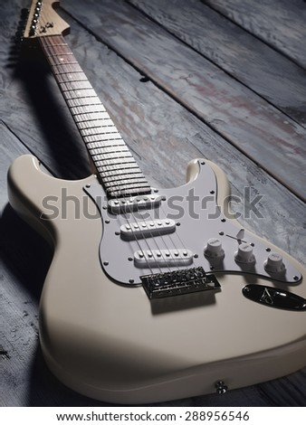 White electric guitar on a wooden background - stock photo