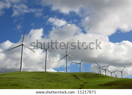 White Electrical Power Generating Wind Turbines on Green Rolling Hills, Altamont Pass,  California