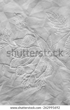 White embroidered cloth closeup as a background