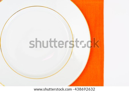 White Empry Plate on a Tablecloth with Place for Your Text Studio Photo - stock photo
