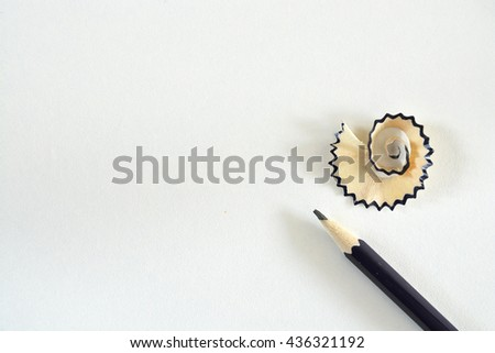 White empty copy space background with black wooden pencil with sawdust of a sharpener - stock photo