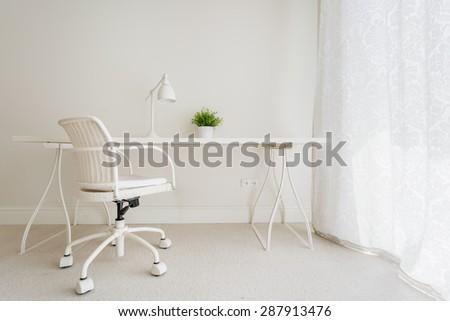 White empty desk in stylish retro interior - stock photo