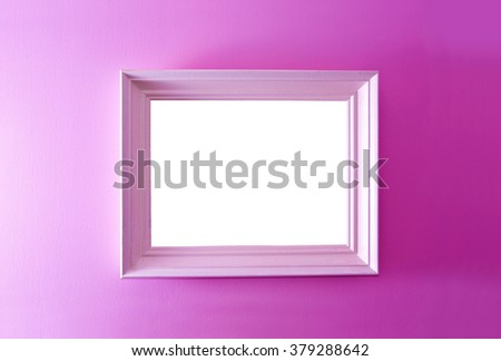 White empty frame on the pink wall. Free copy space. - stock photo
