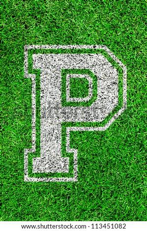 White english alphabet P on green grass - stock photo