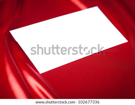 White envelope over red silk background