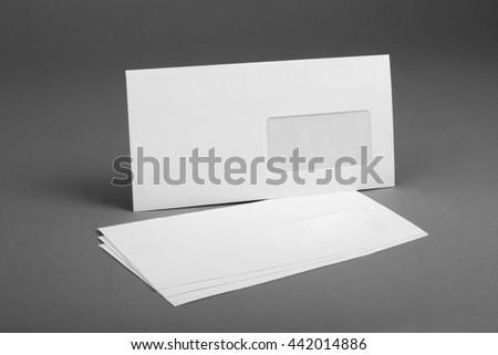 White envelope with address window on gray background - stock photo