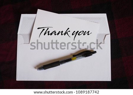 white envelope with thank you letter
