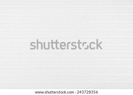 white fabric with striped embroidery.  Can be used as background. - stock photo