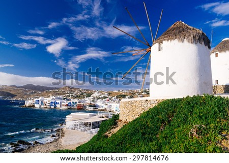 White famous windmills overlooking Little Venice and Mykonos old town, Mykonos, Cyclades, Greece - stock photo