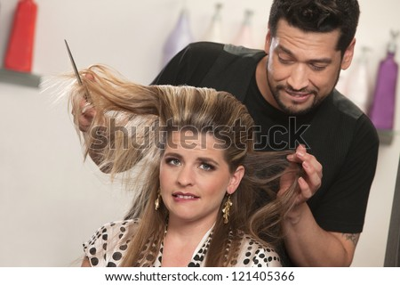 White female biting lip with embarrassed hair stylist - stock photo