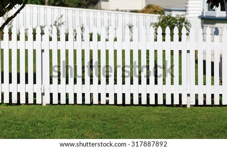 white fence and front yard