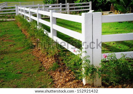 white fence in farm - stock photo