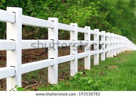 white  fence in farm - stock photo