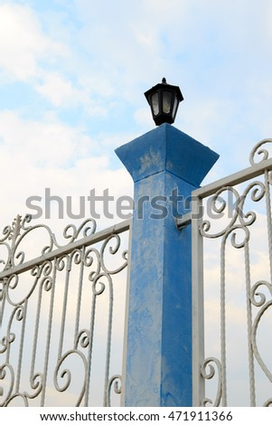 White fence on a blue background