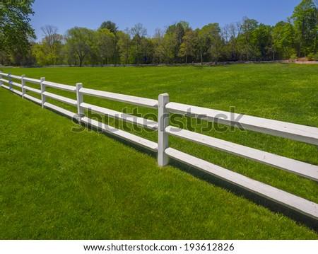 White fence on a farm - stock photo