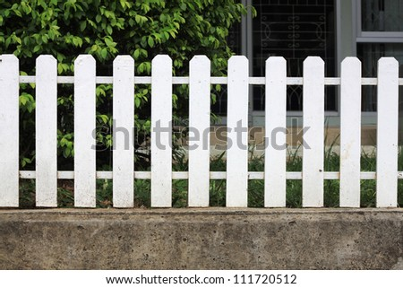 white fence on cement - stock photo