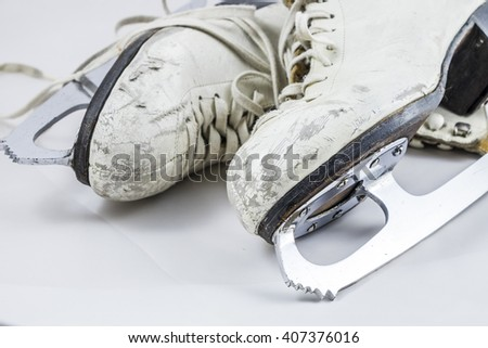 White figure skates scuffed from years of use on a white background. - stock photo