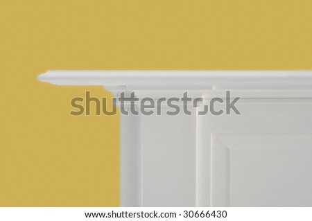 white fireplace mantle against bright yellow colored wall