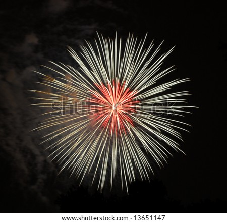 White fireworks with red center on Independence day - stock photo