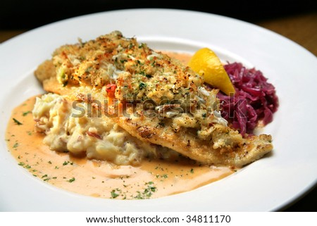 White Fish Covered with Crab Meat, Mashed Potatoes, Cream Sauce - stock photo