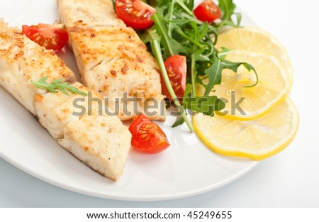 white fish with vegetables and lemon - stock photo