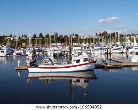 White Fishing Boat Marina with red blue trim