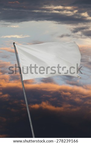 White flag over a cloudy sky after storm at sunset. Peace on war symbol - stock photo