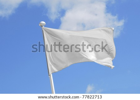 White flag waving over the sky. Promotional and advertisement object - stock photo