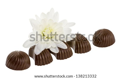 White flower  and black chocolates macro