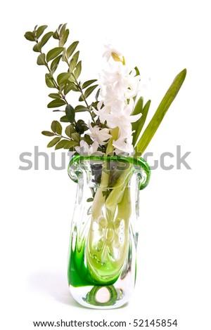 White flower in green vase isolated on white - stock photo