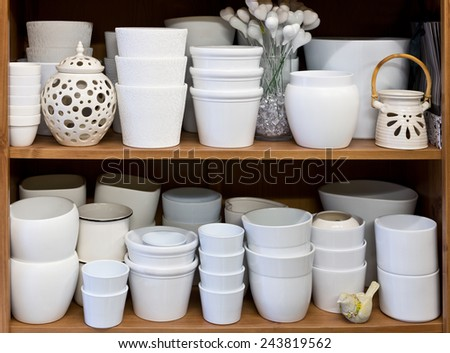 white flowerpots in the florist store