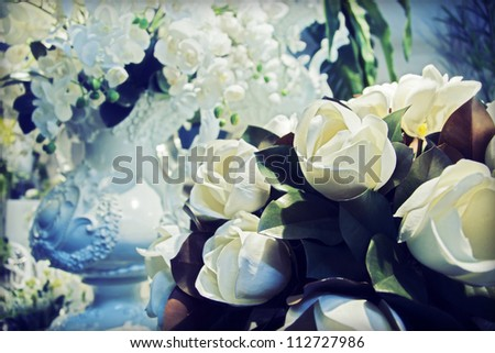 white flowers background and classic vase - stock photo