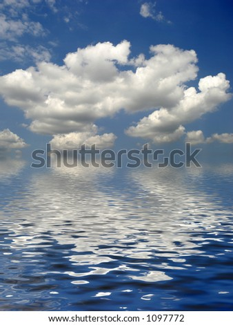 White fluffy clouds cumulus nimbus against a blue sky - stock photo