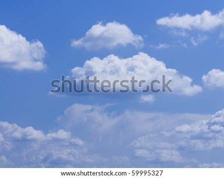 White fluffy clouds highly float in the blue sky - stock photo