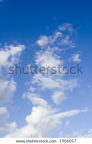 White Fluffy Clouds In A Blue Sky