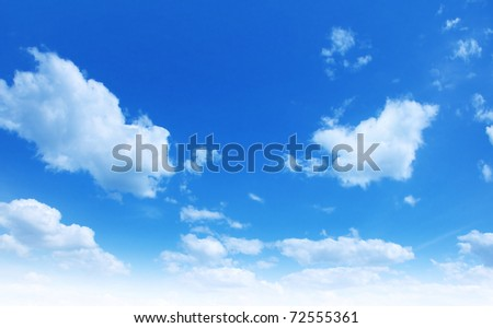 White fluffy clouds in blue sky. - stock photo