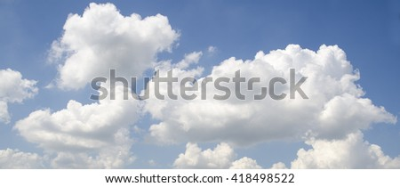 White fluffy clouds in deep blue summer sky. Spiritual calmness and serenity background - stock photo