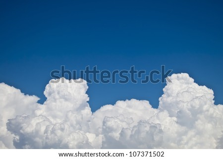 white fluffy clouds over blue sky landscape