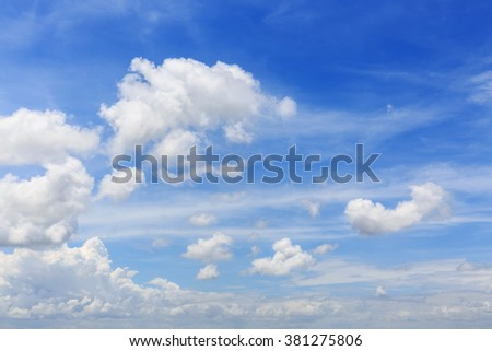 white fluffy cloudy above summer sky background - stock photo