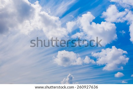 White fluffy cumulus clouds on a blue sky - stock photo