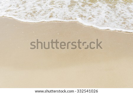 white foam on beach. soft focus on bottom of picture - stock photo